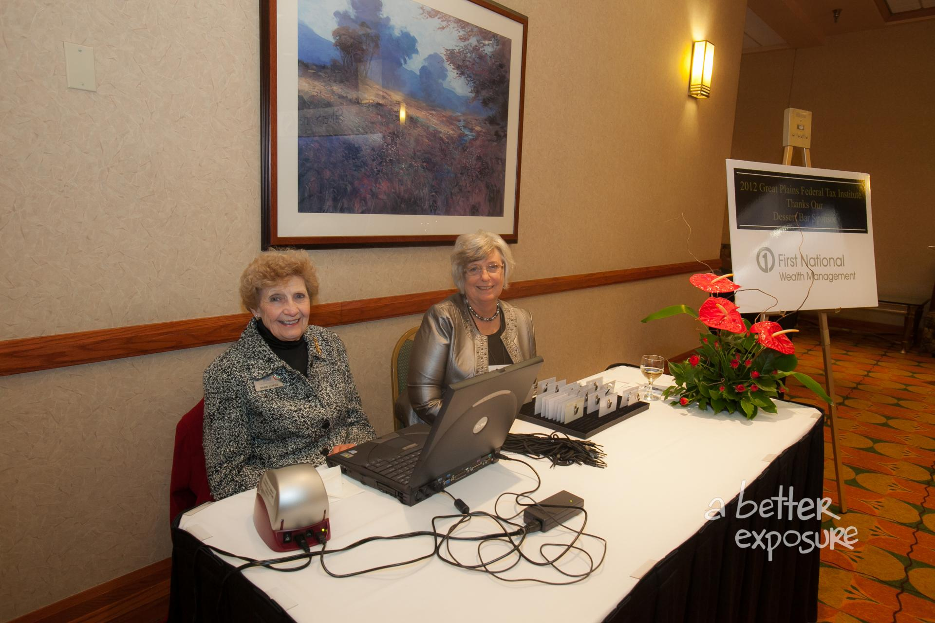 Registration assistants check in guests at the dinner for which First National Wealth Advisors sponsored a dessert bar
