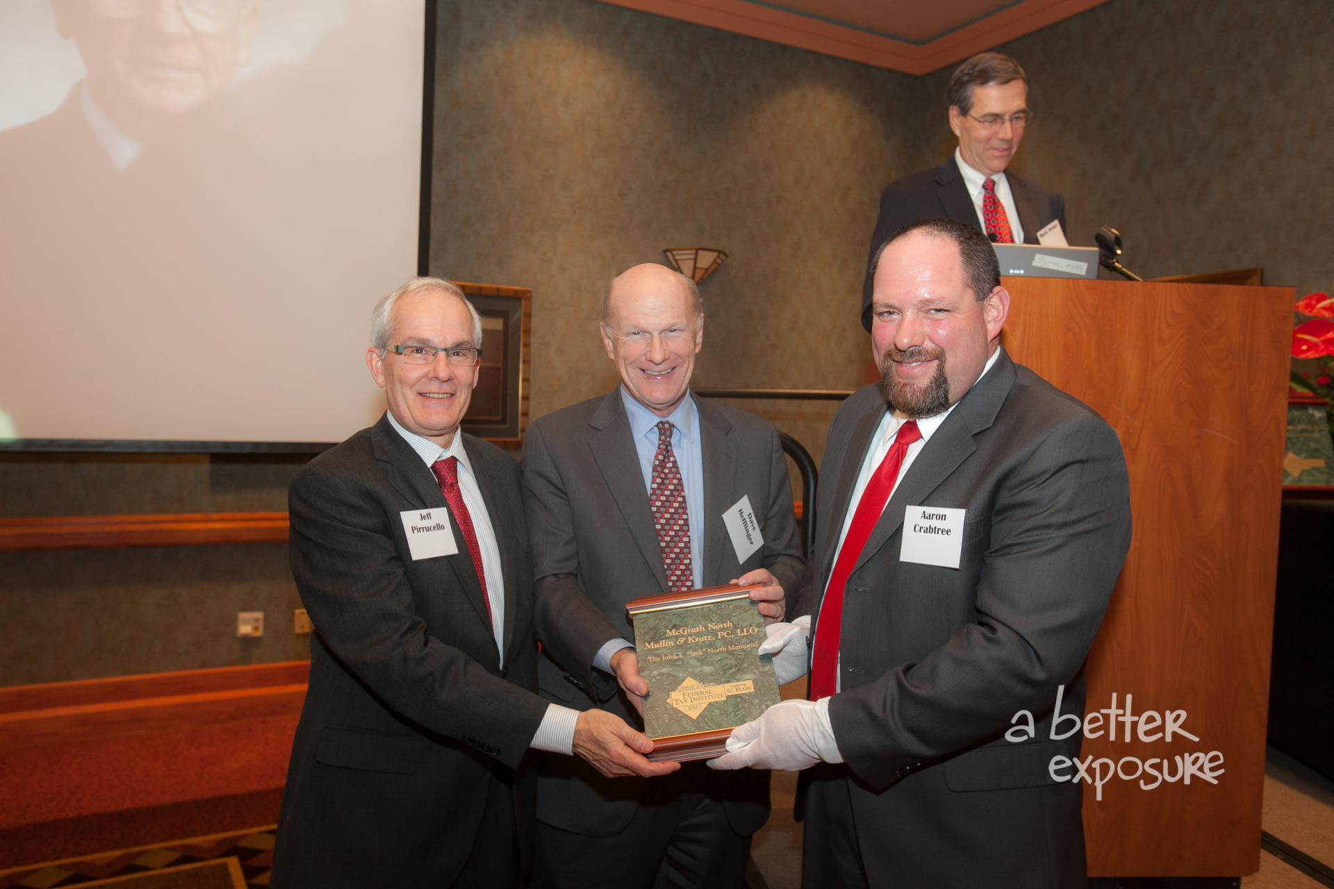 President Aaron Crabtree presents Jeff Pirruccello and David Hefflinger with a plaque